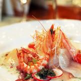 コース料理の一皿例。季節感あふれる新鮮な食材を使用したメニューをご提案致します。