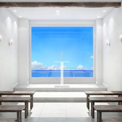 チャペルの大きな窓から青い海を見渡せる