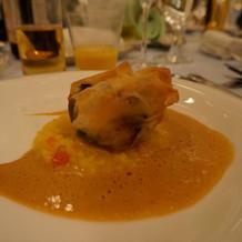 リゾットが添えられた白身魚料理